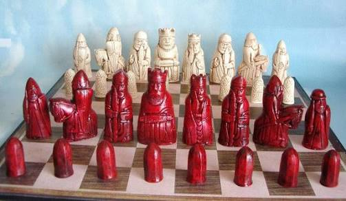 Red And White Pieces With Chessboard Known As