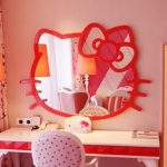 red-hellokitty-wall-mirror-on-soft-pink-wall-with-white-chair-also-red-and-white-dressing-table-and-white-telephone-also-orange-lamp