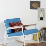 retro blue ikea rocking chair design with white and beige accent and blue upholster and brown patterned rug and wall palette