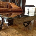 rustic-coffee-tables-vintage-industrial-coffee-table-cart-unique-rail-cart-frame-cast-iron-wheels-and-brackets-and-wooden-floor-and-brwon-sofa
