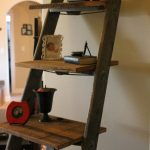 rustic-ladder-shelf-for-rustic-living-room-with-old-style-decoration-and-family-photos-and-old-decorative-items