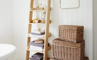 rustic-ladder-shelf-in-the-bathroom-for-towels-and-small-rounded-mirror-near-bathtub-and-square-mirror-hang-on-the-white-wall
