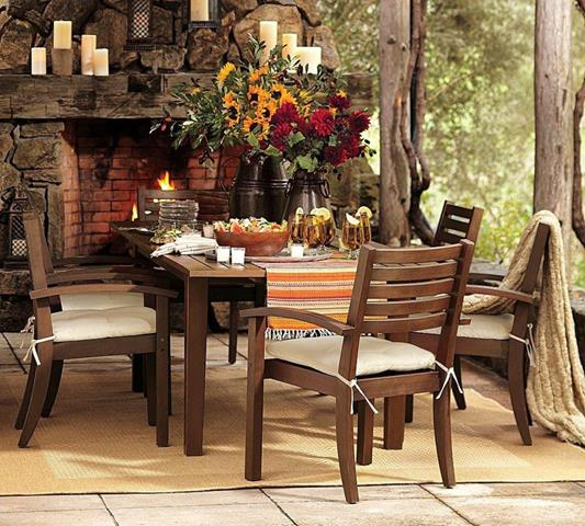 Rustic Outdoor Garden Living Space With Fireplace With Rustic Cheddar And  Table And Wooden Cairs On