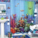sea-themed-bathroom-for-kids-with-underwater-themed-for-the-curtain-carpet-and-trash-can-also-white-sink-and-white-mirror