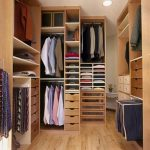 simple and natural wooden dressing room design with plenty of wardrobe storage with wooden floor