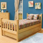 simple and naturalpop up trundle bed frame idea with floral patterned mattress and pillow and wooden flooring and white area rug and blue wall and wall palette
