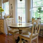 simple beige corner dining table set idea with chandelier and round table and vintage chair and wooden floor and open concept