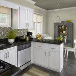 simple black gray and white color kitchen paint idea with white wooden cabinetry and gray storage and backsplash