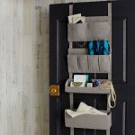 simple cloth over the door basket storage design in gray tone with sack model over black wooden door
