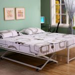 simple white mteal pop up trundle bed frame design with blue wall and wooden floor and gray wall and glass window