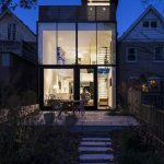 slim house design with open concept and glass facade idea and concrete walkway