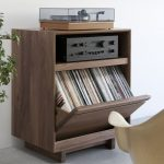 small and boxy ikea stereo cabinet idea with shelf for book aside potted plant with white vintage chair