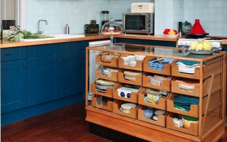 small-kitchen-with-brown-wooden-cabinet-for-storages-like-plates-glasses-mugs-dishtowels-bowls-and-maroon-floor-also-blue-cabinet-and-microwave-and-soft-blue-ceramic-wall