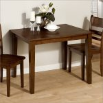 small rectangular dining table for tiny dining room space decorated with two wooden chairs and beautiful flower centerpiece and hardwood floor