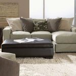 small sectional design with chaise and neutral pillows white shaggy rug idea black leather bench as the table modern black coated wooden side table with metallic decorative pot
