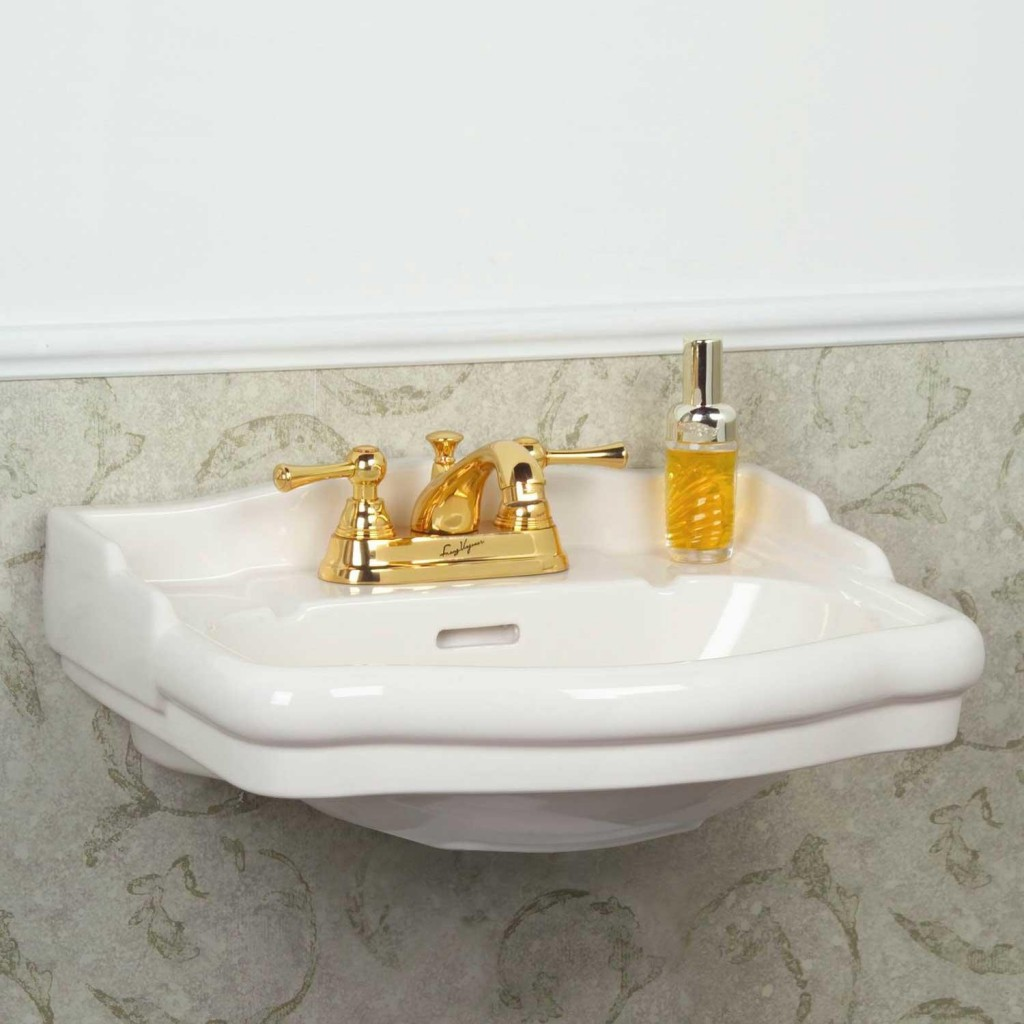 Small White Wall Mounted Sink With Gold Tone Faucet