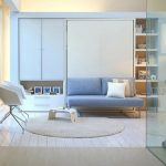 soft blue couch of murphy bed with couch idea with round rug on wooden floor and white chairs and storage