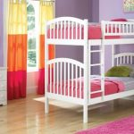 soft purple bedroom idea with white low profile bunk bed idea with white vanity with wall mirror and storage and pink rug