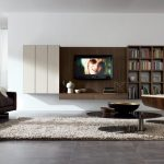 space saving wall mounted entertainment system furniture in modern living room ideas plus bookcase mounted on the wall ad furry rug plus unique round table