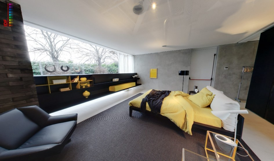 Spacious Bedroom Decor With Gray And Yellow Color Combination With Gray Sofa And Black Shelves And