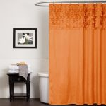 stunning and elegant oange art deco shower curtain design with curved rod idea with white bathtub and wooden vanity with frame and towel storage
