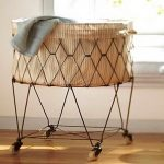 stunning and unique hamper with wheel design in round shaped with diamond pattern and diamond shaped metal legs