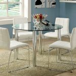 Stunning Blue All Glass Dining Table Design With White Modern Chairs And Round Shape And Vased Flowers And Black Chandelier And Creamy Area Rug