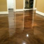stunning brown glossy floor painting idea with yellowish wall paint and white molding