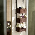 stunning brown over the door basket storage design for pillows with black iron pipe frame on white door