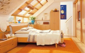 stunning creamy and yellowish loft bedroom idea with skylight and white bedding and long console and wardrobe