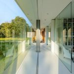 stunning large and open best efficient home interior design with super large bookshelves and floor to ceiling glass wall