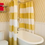 stunning yellow bohemian chower curtain design with curved rod and stripe pattern and white tub and wallpaper and wall shelves