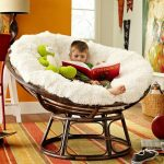 stylish-and-big-white-papasan-chair-for-kids-and-green-doll-and-orange-carpet-also-orange-color-wall-and-lamp-and-pictures