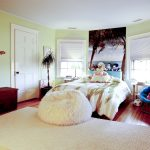 stylish-and-pretty-kids-bedroom-with-bright-blue-papasan-chair-and-pink-cushion-near-white-carpet-on-the-wooden-floor-also-brown-wooden-cabinet-and-dresser