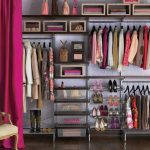 stylish dress up storage idea with metal racks and hanger for clothing and shoes and bag with pink curtain