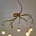 stylish octopus shaped cool hanging light idea with plenty of golden lamps with white brick wall