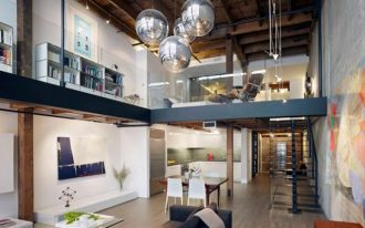 super comfortable double height interior design with black loft idea with pendants and black sofa and wooden ceiling