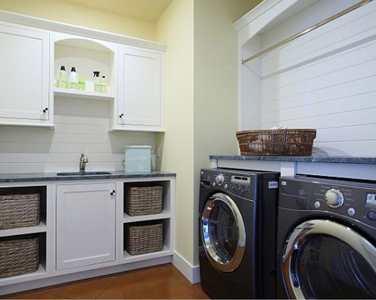 Tidy And Livable Laundry Room Idea With Washing And Drying Machines And  White Wall And Basket