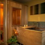 traditional bathroom design withbeige tone water storage and wooden bench and sauna
