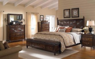 traditional end of bed storage bench with drawers and metal handles decorated in classic bedroom ideas with light rug and hardwood floor