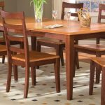 traditional vintage dining table idea with wooden fining chairs and white patterned area rug and wooden floor
