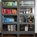 two-coloumns-and-four-rows-with-8-doors-metal-barrister-bookcase-for-books-and-bottles-and-wooden-floor