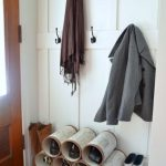 unique diy pipe shoes and boot storage idea with white siding and hooks and white color and area rug and mud room