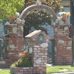 unique rustic brick mailbox design idea with home shape and planter
