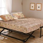 vintage and simple metal pop up trundle bed frame idea with tropical floral pattern with wooden floor and glass window and sheer white curtain