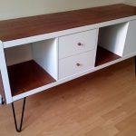 vintage brown white ikea stereo cabinet idea with black iron legs on wooden floor beneath white wall