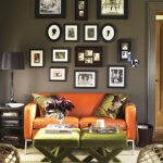 Wall Decoration With Displaying Frame Family Photos On The Grey Wall Combined With Orange Sofa And Dark Grey Table Lamp
