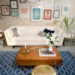 wall-decoration-with-midcentury-gold-wallpaper-and-vintage-art-galleries-hang-on-it-also-rustic-coffe-table-with-white-sofa