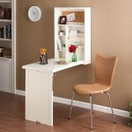 wall  mounted folding desk with shelving unit a working chair
