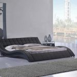 wavy low profile platform bed frame made of leather for modern bedroom ideas plus grey furry rug and modern nightstand